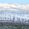 〈朝鮮名峰への旅 1〉春霞の中から柔らかな光、白頭山が染まっていく